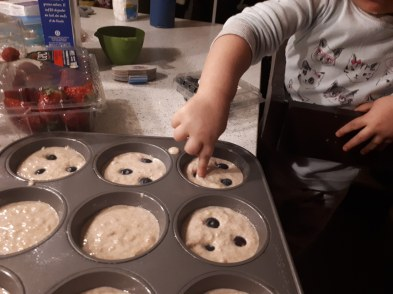 toddler cooking pancake muffins blueberries breakfast
